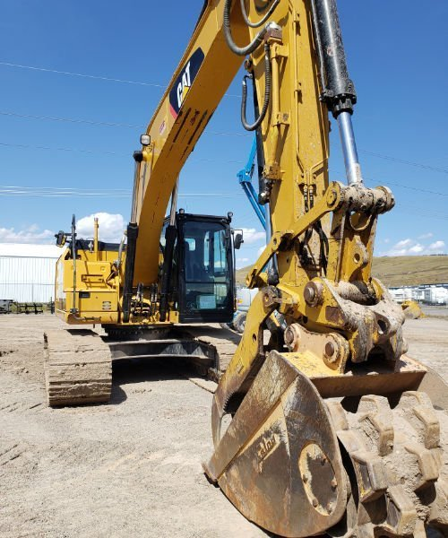 CAT excavator with Felco Roller bucket