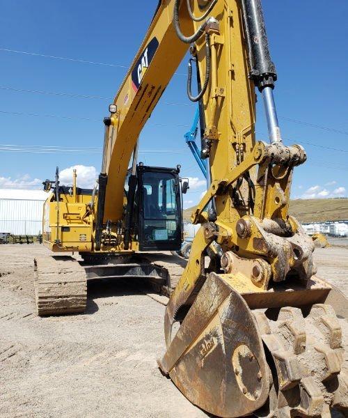 CAT excavator with Felco Roller bucket