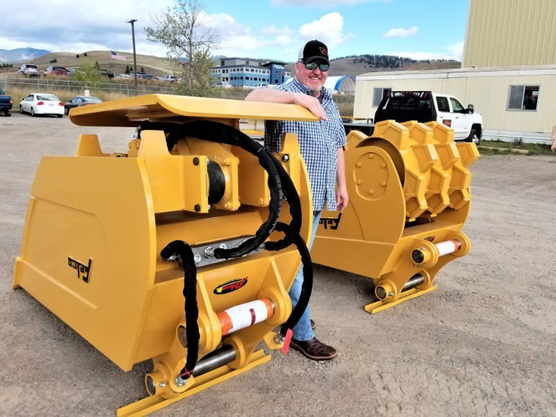 Shawn Pabst next to Compaction Buckets